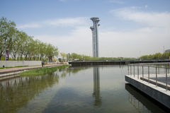Asia Chinese, Beijing, Olympic Park, the lake and the watchtower. Royalty Free Stock Images