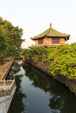 Asian Chinese garden. Chinese classic garden Garden in China Asia. Chinese traditional architecture building by a stream with classical designs and patterns in Royalty Free Stock Images