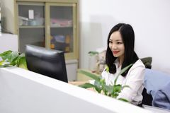 Asia Chinese office lady woman girl on chair thinking drink tea work laptop computer smile wear business occupation suit workplace stock photo