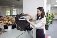 Asia Chinese Office Lady Woman Girl Print Copy Paper Use Printer Copier At Work Smile Wear Business Occupation Suit Workplace Stock Image