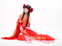 Asia Chinese style girl in red traditional dress dancer sit. Asia Chinese girl in red traditional dress dancer stock photography