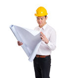 Asia construction engineer reading on blueprint Royalty Free Stock Photo