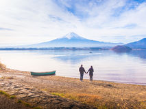 Asia couple traveler 30s to 40s stand by hold one& x27;s hands and ta royalty free stock photos