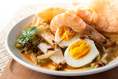 Asia cuisine lontong ketupat rice cake. Traditional food from indonesia, lontong sayur. rice cake, vegetables and shrimp with coconut milk soup Royalty Free Stock Images
