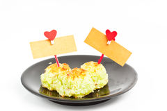 Asia dessert with card bank paper and hearts on the clothesline Stock Images