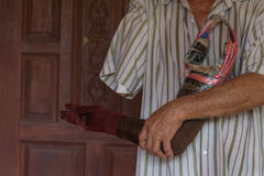 Asia elderly man with one arm and arm prosthetic Stock Images