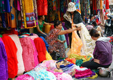 Asia fabric market. HO CHI MINH CITY, VIET NAM- DEC 28: Asia fabric market, colorful roll of cloth for clothing show at store, Vietnamese woman choice at shop royalty free stock photo