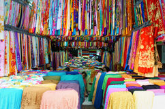 Asia fabric market. HO CHI MINH CITY, VIET NAM- DEC 28: Asia fabric market, colorful roll of cloth for clothing show at store, Vietnamese woman work at shop royalty free stock photography