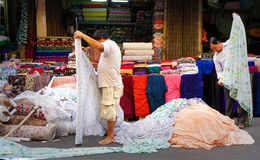 Asia fabric market. HO CHI MINH CITY, VIET NAM- DEC 28: Asia fabric market, colorful roll of cloth for clothing show at store, Vietnamese worker working at shop royalty free stock images