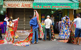 Asia fabric market. HO CHI MINH CITY, VIET NAM- DEC 28: Asia fabric market, colorful roll of cloth for clothing show at store, Vietnamese worker working at shop royalty free stock photo