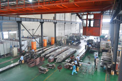Asia factory. Workers were working in a bright modern components mould factory in Zhangjiang high-tech development park, the most famous science park in Pu royalty free stock images