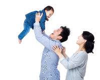 Asia father throw his baby up with smile wife Royalty Free Stock Photos
