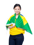 Asia female soccer fans draped with Brazil flag Stock Photography
