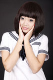 Asia female student. Cute Asian female student in uniform on dark Stock Photography