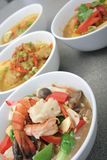 Asia food. Seafood from chinese named chap chai with other asia food at background Stock Images