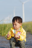 Asia girl. A asia girl playing on a wind farm Royalty Free Stock Photography