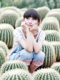 Asia girl in cactus field Stock Photos