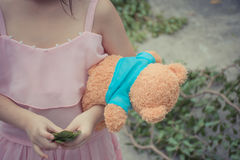 Asia girl child cute with teddy bear Royalty Free Stock Images