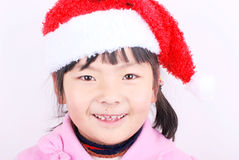 Asia girl with Christmas hat Stock Images
