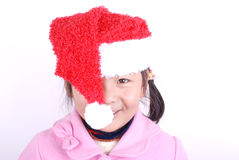 Asia girl with Christmas hat Royalty Free Stock Images