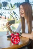 Coffee or Tea Break. Asia girl drink hot coffee or tea break at 02.30 pm in cafe stock image