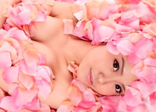 Asia girl in flower. An asia girl in pink flowers stock images