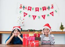 Asia girl friends wear santa hat in Christmas and new year party Stock Image