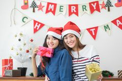 Asia girl friends wear santa hat in merry christmas and new year Royalty Free Stock Photo