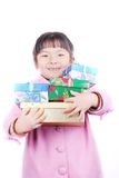 Asia girl with gifts in arms Royalty Free Stock Photos