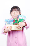 Asia girl with gifts in arms Stock Photography