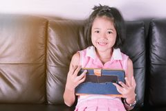 Asia girl happy play tablet stock images