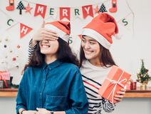 Asia girl lovers couple,girlfriend close eye to surprise friend. By giving Christmas present  at house party,Holiday celebrating season,Lovely lesbian couple Royalty Free Stock Photo