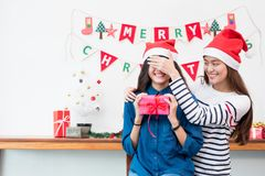 Asia girl lovers couple,girlfriend close eye to surprise friend. By giving Christmas present  at house party,Holiday celebrating season,Lovely lesbian couple Stock Image