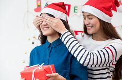 Asia girl lovers couple,girlfriend close eye to surprise friend. By giving Christmas present  at house party,Holiday celebrating season,Lovely lesbian couple Royalty Free Stock Photography