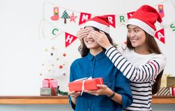 Asia girl lovers couple,girlfriend close eye to surprise friend. By giving Christmas present  at house party,Holiday celebrating season,Lovely lesbian couple Royalty Free Stock Photos