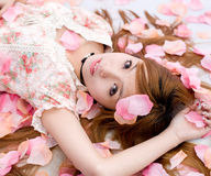 Asia girl in flower. An asia girl in pink  flowers stock photo