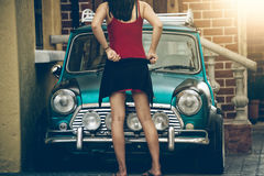Asia girl posing in front of vintage car. Portrait of Asia girl posing in front of vintage car on summer day royalty free stock image