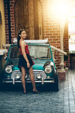 Asia girl posing in front of vintage car. Portrait of Asia girl posing in front of vintage car on summer day stock photos