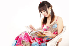 Asia girl reading magazine Stock Images