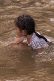 Asia girl in river Stock Photography