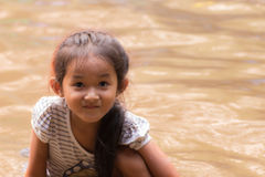 Asia girl in river Stock Photo