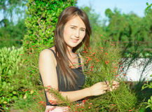 Asia girl smile and touch flower Stock Photos