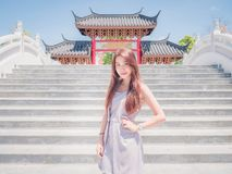 The Asia girl in temple Royalty Free Stock Photo
