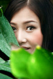 Asia gorl. A beautiful asia smiling woman,close-up Royalty Free Stock Photography