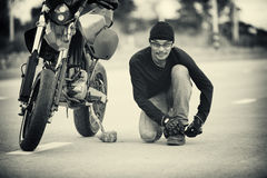 Asia handsome man biker call telephone on the motorcycle Stock Images