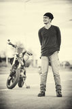 Asia handsome man biker call telephone on the motorcycle Royalty Free Stock Image