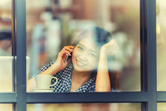 Asia happy woman talking  phone in cafe and enjoying coffee Stock Image