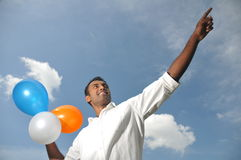 Asia Indian Man holding colorful balloons Royalty Free Stock Images