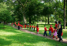 Asia kid activity team building. HO CHI MINH, VIETNAM- AUG 16: Extracurricular activity of preschool education, Asia kid in team building at green park of Royalty Free Stock Photography