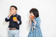 Asia kid ,boy and girl eating fruit Royalty Free Stock Photo